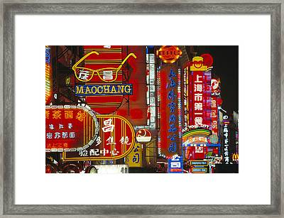 Neon Signs In Nanjing Lu, Shanghais Framed Print by Justin Guariglia