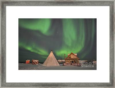 Northern Lights Above Village Framed Print by Jiri Hermann