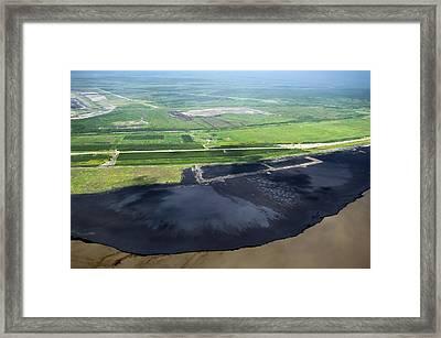 Oil Plant Settling Pond Framed Print by David Nunuk