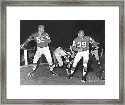Framed Print featuring the photograph Old School Roller Derby With The Sf 49ers And Oakland Raiders by Jim Fitzpatrick