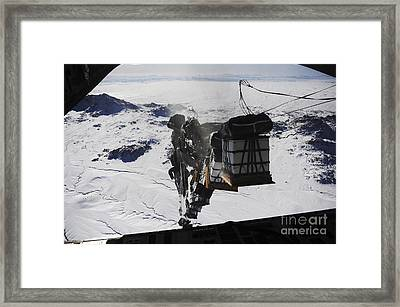 Pallets Are Released From A C-130 Framed Print by Stocktrek Images