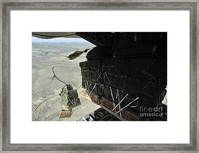 Pallets Roll Out Of A C-130 Hercules Framed Print by Stocktrek Images