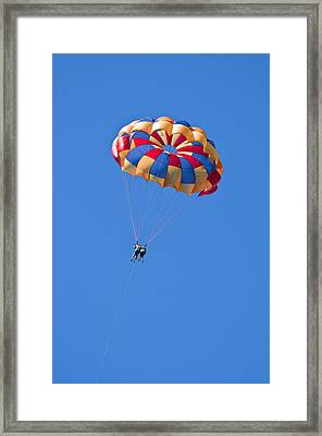 Parasailing Under Blue Sky. Framed Print by Fernando Barozza