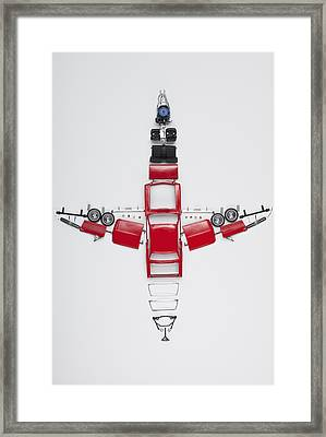 Parts Of A Model Car Arranged In The Form Of An Airplane Framed Print