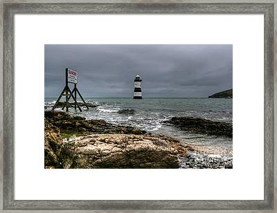 Penmon Point Framed Print by Adrian Evans