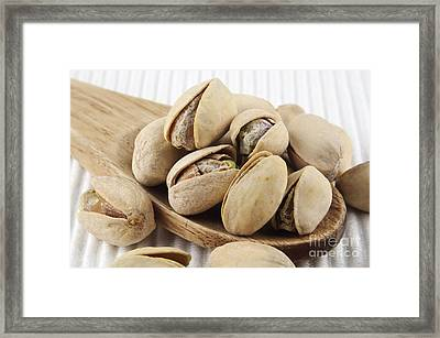 Pistachios On Spoon Framed Print by Blink Images