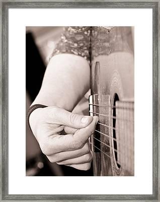 Playing Guitar Framed Print by Tom Gowanlock