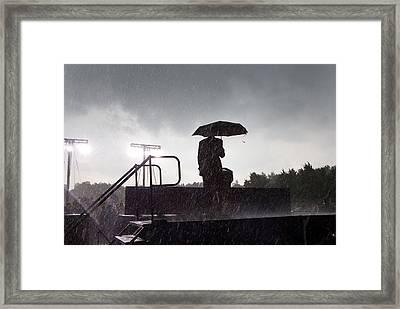President Barack Obama In The Rain Framed Print by Everett