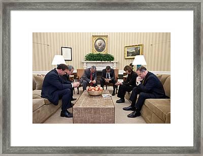 President Barack Obama Prays Framed Print