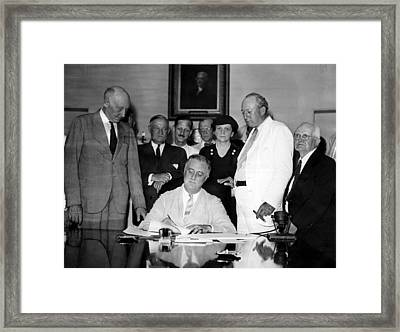 President Franklin D. Roosevelt Signing Framed Print by Everett