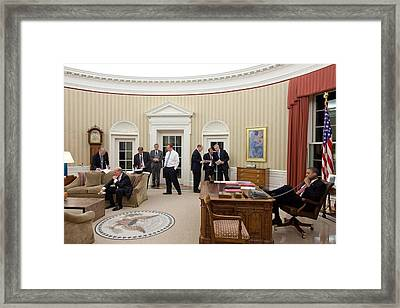 President Obama Talks On The Phone Framed Print