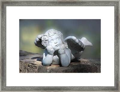 Reclining Angel Framed Print by Linda Phelps