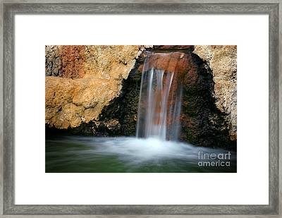 Red Waterfall Framed Print by Carlos Caetano