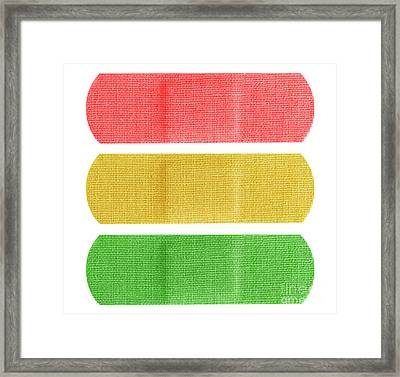 Red Yellow And Green Bandaids Framed Print