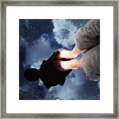 Reflection Of Boy In A Puddle Of Water Framed Print