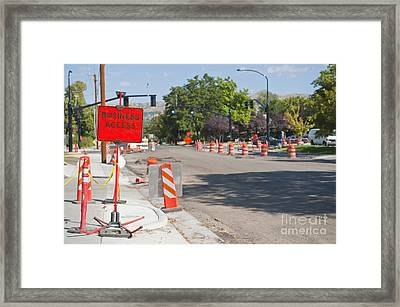 Road Construction On City Street Framed Print by Thom Gourley/Flatbread Images, LLC