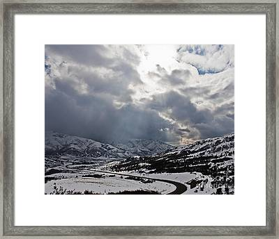 Road Through A Snowy Mountain Landscape Framed Print by Thom Gourley/Flatbread Images, LLC