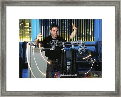 Robotic Arms Framed Print by Volker Steger