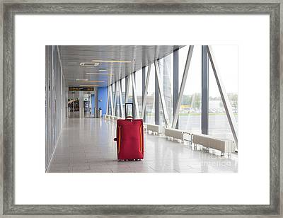 Rolling Luggage In An Airport Concourse Framed Print