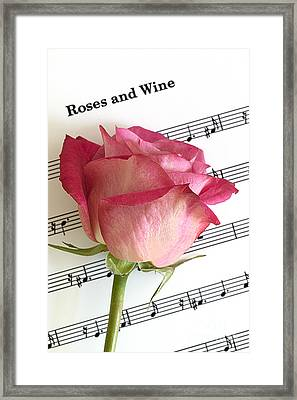 Roses And Wine Framed Print