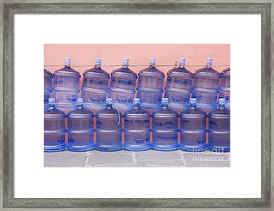 Rows Of Water Jugs Framed Print by Jeremy Woodhouse
