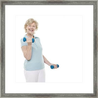 Senior Woman Lifting Weights Framed Print by