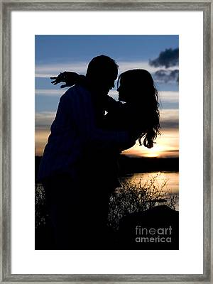 Silhouette Of Romantic Couple Framed Print