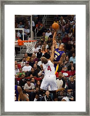 Slam Dunk Framed Print by Eddie Yerkish