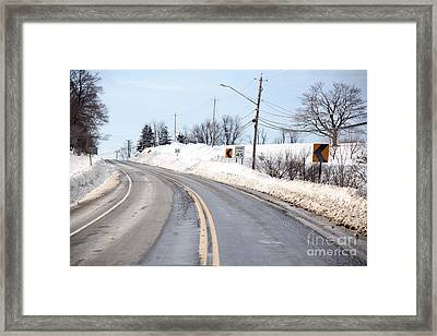 Snow By The Roadside Framed Print by Ted Kinsman