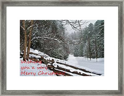 Snowy Fence Framed Print by Debra and Dave Vanderlaan