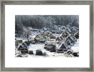 Snowy Village Framed Print by Kean Poh Chua