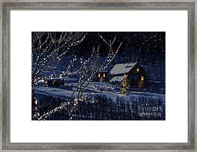Snowy Winter Scene Of A Cabin In Distance  Framed Print by Sandra Cunningham
