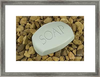 Soap Bar On Stones Background Framed Print by Blink Images