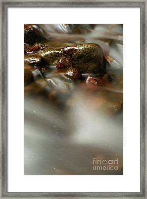 Stones In River Framed Print by Odon Czintos