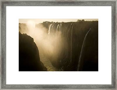 Sunlight Illuminates Mist Rising Framed Print by Ralph Lee Hopkins