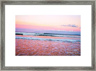Sunset In The Waves Framed Print by Michele Penner