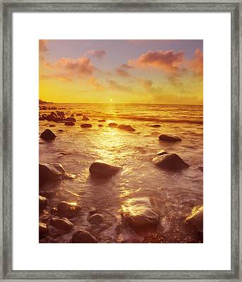 Sunset Over The Sea Framed Print by Tony Craddock