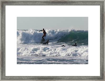 Surfers At Porthtowan Cornwall Framed Print by Brian Roscorla