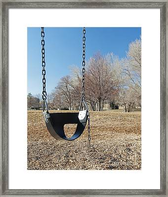 Swing Set On A Grass Field Framed Print by Thom Gourley/Flatbread Images, LLC