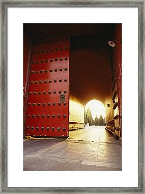 The Giant Red Doors To The Forbidden Framed Print by Justin Guariglia