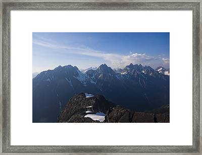 The Jagged Tops Of High Mountain Peaks Framed Print