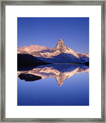 The Matterhorn Reflecting In Lake Framed Print by Brian Lawrence