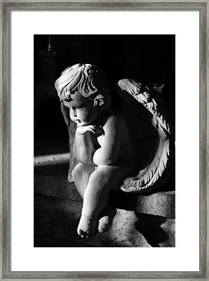 Thoughtful Cherub Framed Print