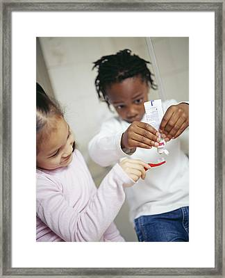 Toothbrushing Framed Print by Ian Boddy