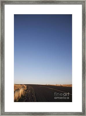 Two Lane Road Between Fields Framed Print by Jetta Productions, Inc