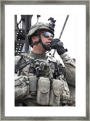 U.s. Army Soldier Communicates Framed Print by Stocktrek Images