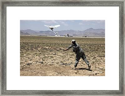 U.s. Army Soldier Launches An Rq-11 Framed Print