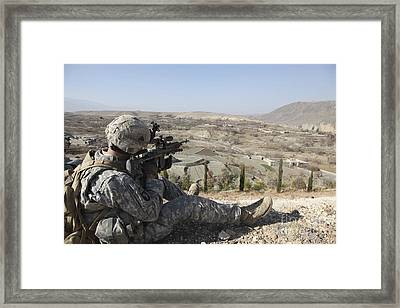 U.s Army Soldier Scans His Sector Framed Print by Stocktrek Images