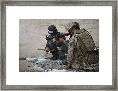U.s. Marine Watches An Afghan Police Framed Print by Terry Moore