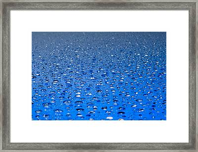 Framed Print featuring the photograph Water Drops On A Shiny Surface by Ulrich Schade